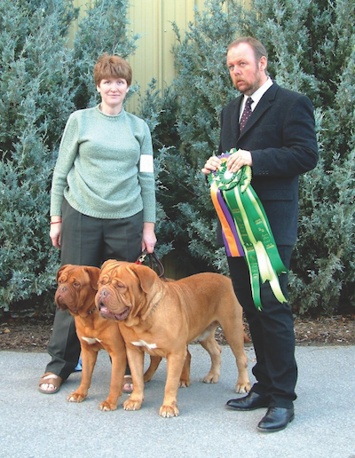 Northland's Goro (right) and Tess of Northland with judge Bas Bosch of Belgium.