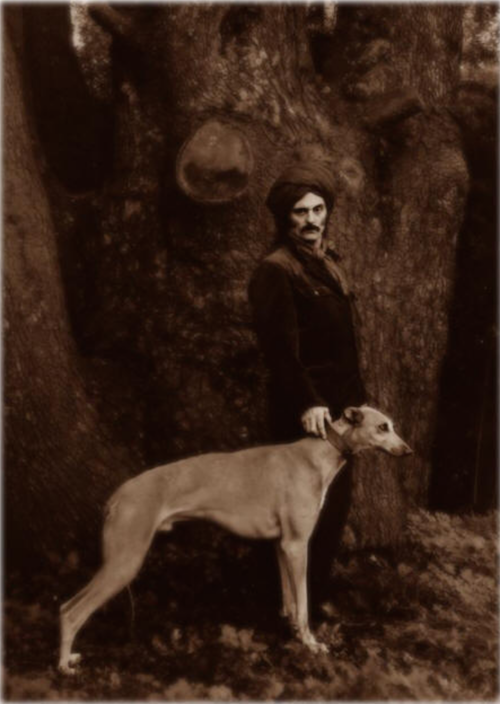 Gasche poses with one of is lpng-ago Greyhounds for an iconic photo that appeared on the cover of one of his photography books.